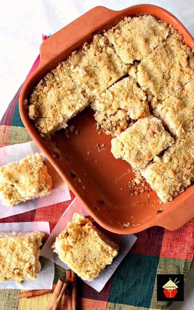 Delicious Apple Crumble Bars. These are absolutely out of this world! Chunks of apple filling on a lovely shortbread base and topped off with a delicious crumble. Really easy recipe too!
