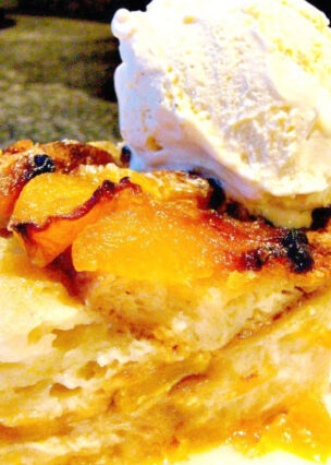 Peach Croissant Bread Pudding. An easy dessert recipe made up of croissants and juicy peaches all baked in a delicious sweet coconut custard. Delicious served warm or chilled