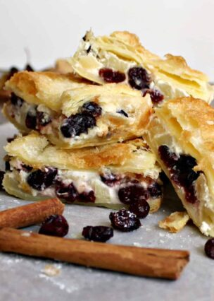 Apple and Cranberry Crescent Roll Cream Cheese Bars. An incredibly quick & easy recipe, sweet cream cheese puff pastry sandwiches loaded with juicy apples and cranberries makes for a perfect sweet snack