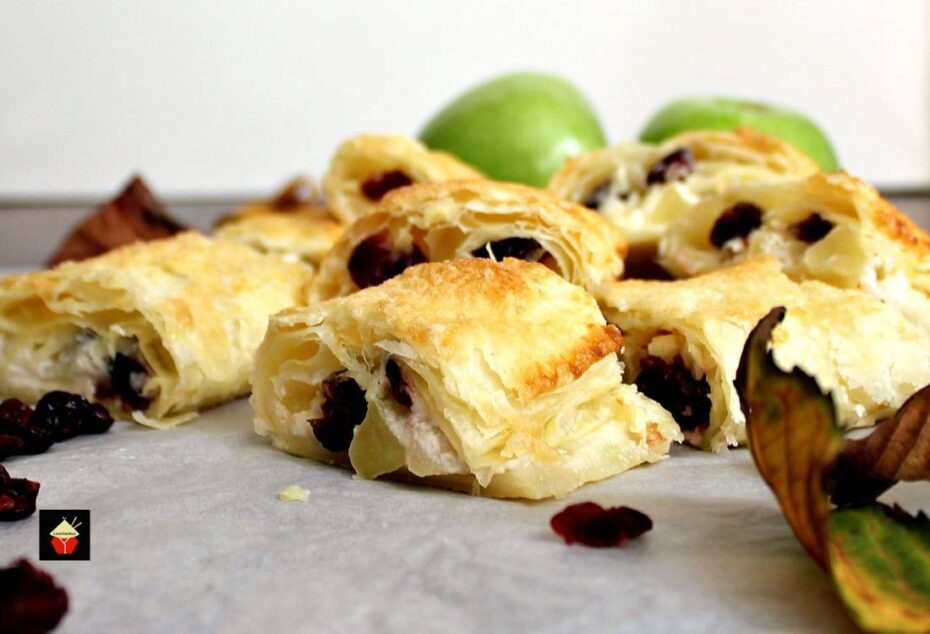 Apple and cranberry cream cheese filling baked in layers of crispy puff pastry. A great snack, tea party and buffet food. Also delicious for breakfast too!