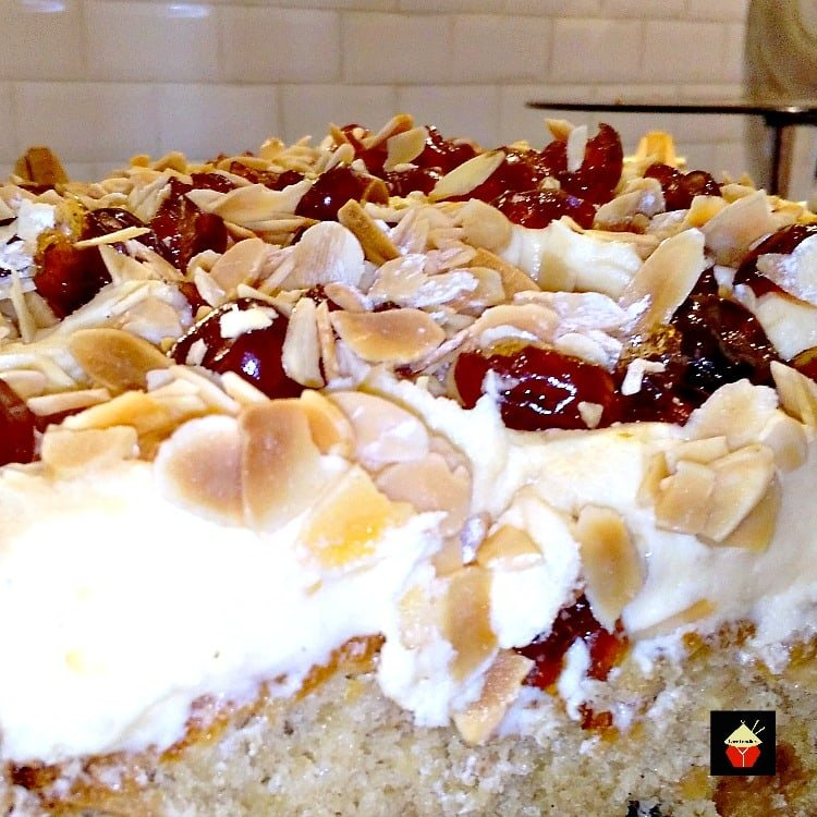 Cherry Almond Cake with Cream Cheese Frosting is a lovely soft cake and great tasting. Perfect for parties too!