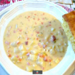 Prize Winning Cheddar and Ham Chowder is a slow cooked, rich, creamy soup made of ham, cheese, and potatoes. Homemade comfort food, ideal for a cold Winter's night. Delicious served with a chunk of cornbread.