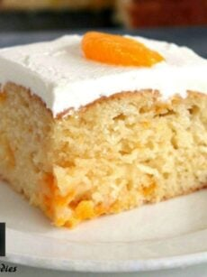 Mandarin Cake. A delicious soft cake with juicy mandarins running throughout , topped with fresh whipped cream. A perfect cake for an English Afternoon Tea