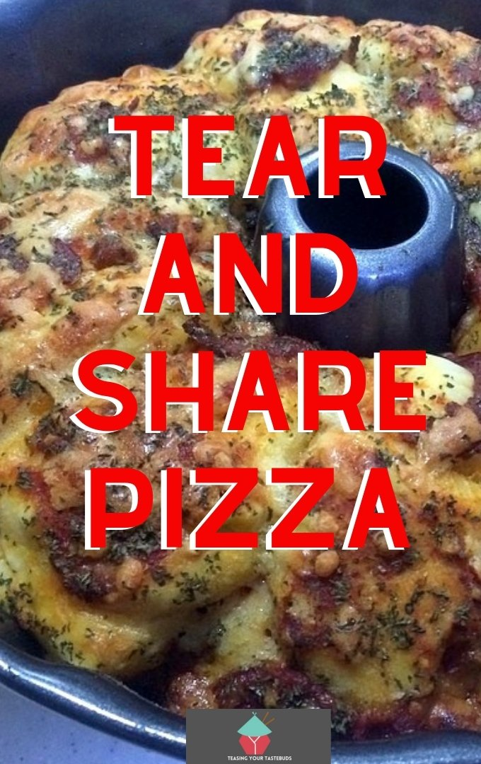 Tear and Share Pizza is a delicious recipe made using biscuit dough, mozzarella, pepperoni and pizza sauce. Simply tear a piece off and pass around with your friends and family