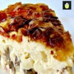 This Celebration Breakfast Casserole is a full breakfast, brunch or supper time dish, loaded with mac n cheese, baby meatballs and bacon, comfort food at its best!