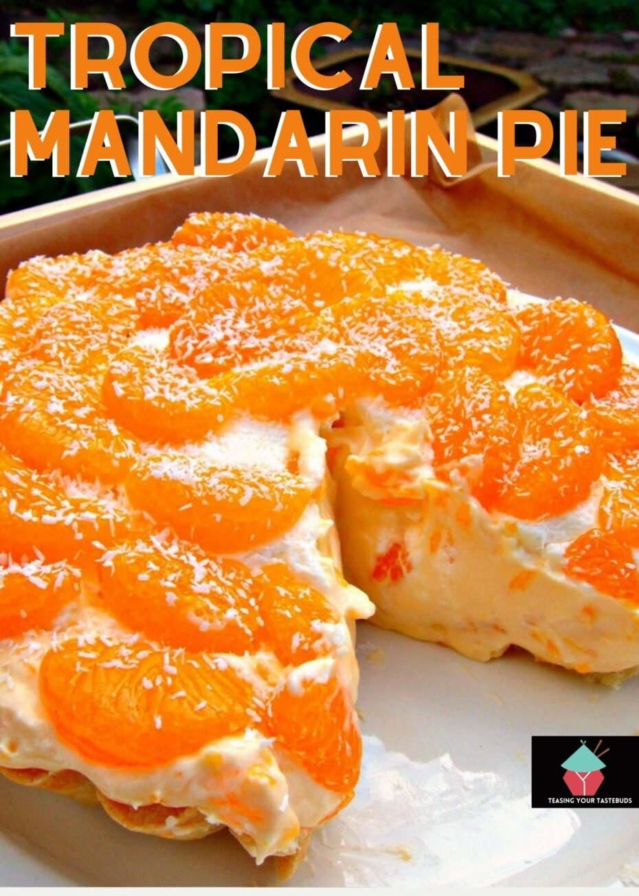 Homemade Tropical Mandarin Pie, made up of a crispy buttery pastry case, filled with delicious creamy coconut custard, and laced throughout with juicy mandarins.