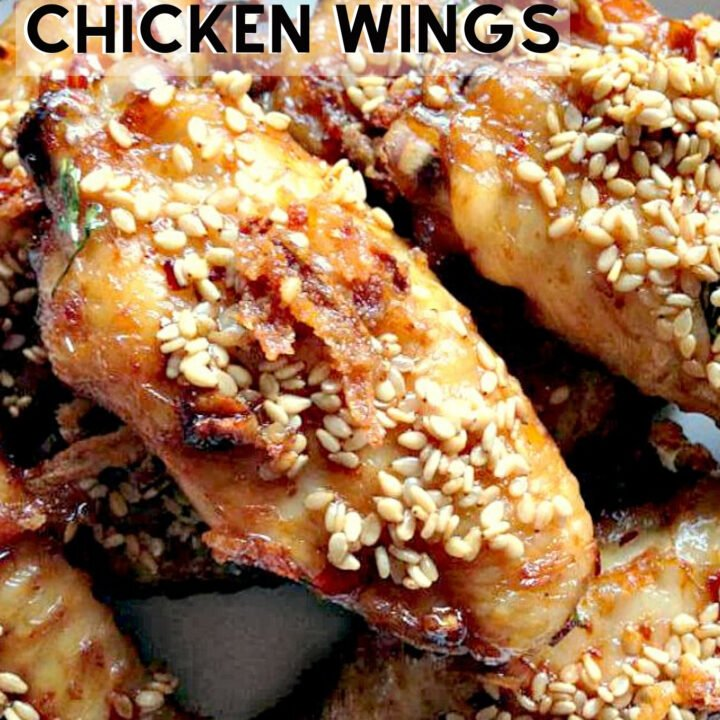 Spicy Brown Sugared Chicken Wings. Deliciously baked wings, coated in brown sugar, baked onions and spices then coated in sesame seeds. Perfect party food!