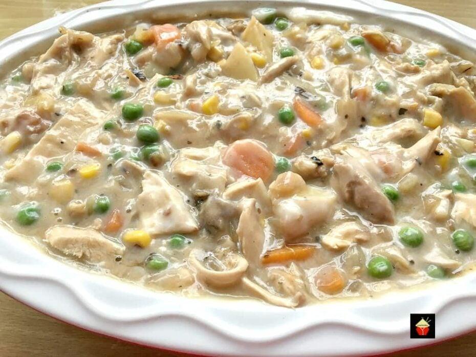 Left Over Roast Chicken Pot Pie, adding filling to casserole dish