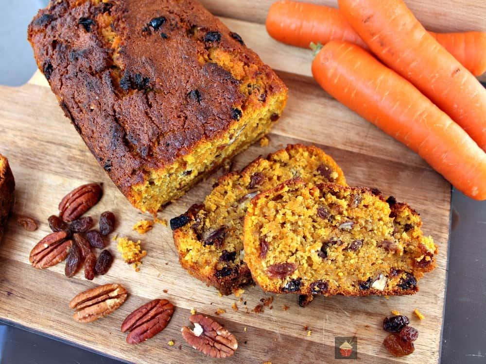 Spiced Pecan Carrot Cake! A delicious spiced cake made from scratch. Fluffy, soft and bursting with the flavors of Fall! Perfect for Thanksgiving, Christmas holidays!  #Cake #Thanksgiving #Christmas #Easter #Fall #Carrotcake #Winter