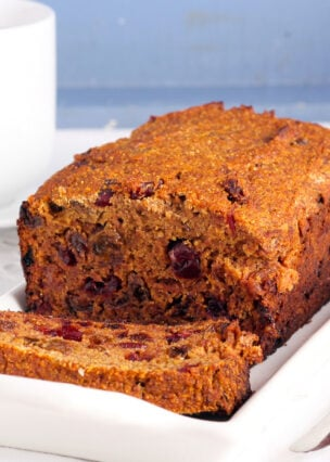 Caribbean Rum Cake, an easy delicious recipe! The cake is soft and moist, packed with rum infused raisins and makes for a great Christmas time cake.