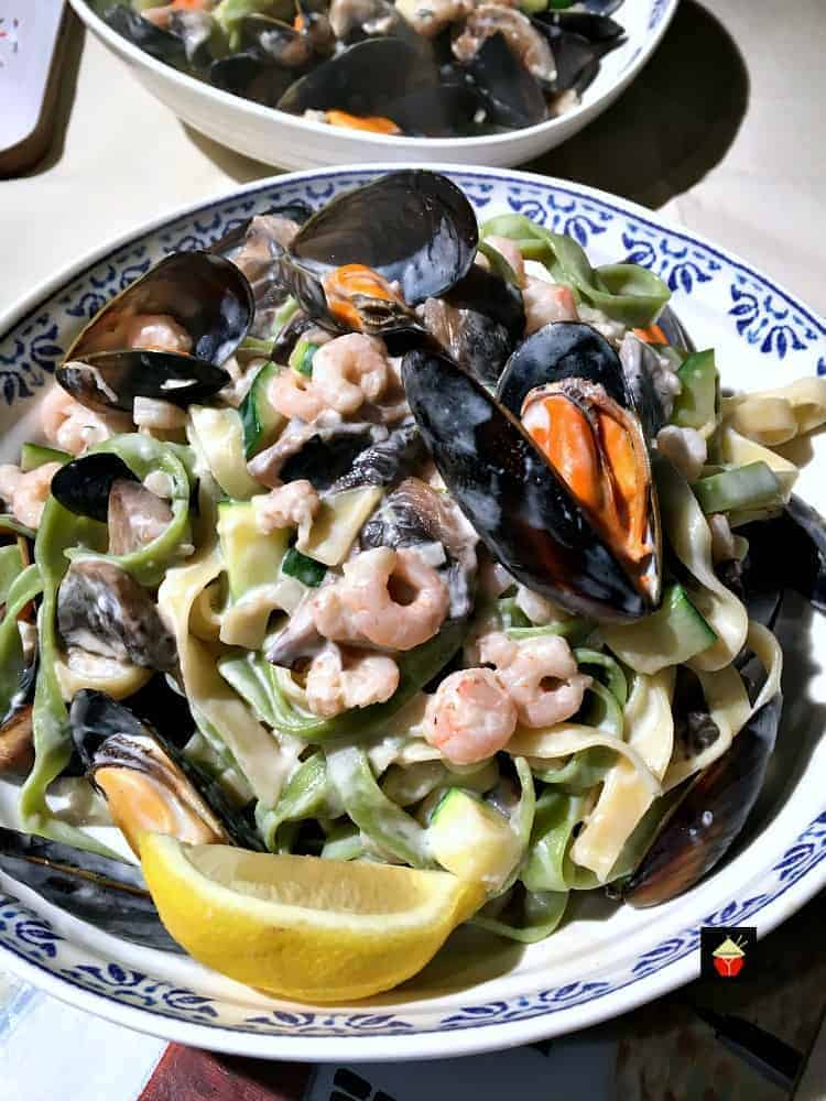 Creamy Garlic Seafood Pasta, a delicious quick and easy meal, shrimp and mussels with a delicious creamy white wine sauce.