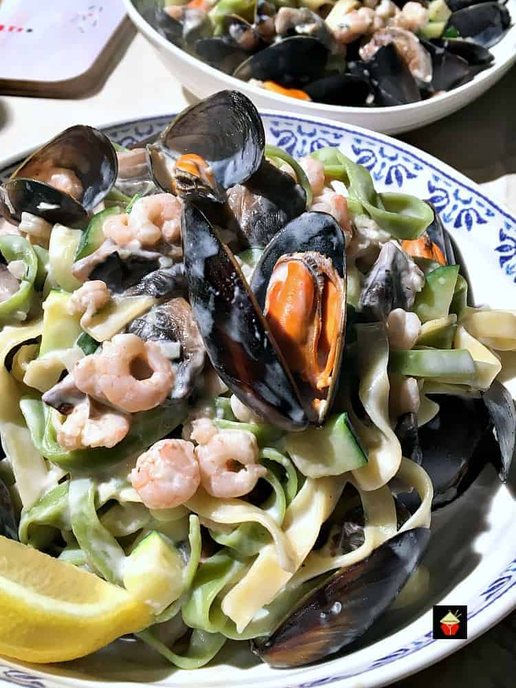 Creamy Garlic Seafood Pasta, a delicious quick and easy meal, with a delicious creamy white wine sauce.