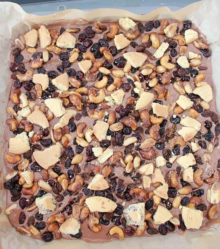Irish Cream Chocolate Bark! A delicious chocolate treat loaded with cranberries, cookies and honey spiced nuts. Perfect for the holidays and great for gifts.