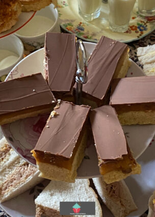 Millionaire's Caramel Shortbread are layers of buttery crumbly shortbread, sticky caramel, and topped with a generous layer of chocolate. A classic British treat