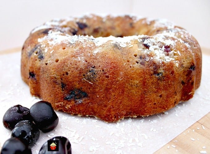 Cherry and Coconut Cake is a wonderful buttery, soft pound cake bursting with cherries in every bite! The flavor is out of this world, rich in coconut. Bake in a bundt pan or loaf pan