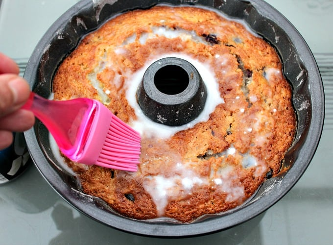 Coconut Cherry Cake showing cake after baking and adding coconut milk on the topping