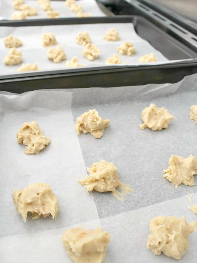 teaspoonfuls of grandma's war time peanut drop cookies on baking sheet to show size and distance apart on tray