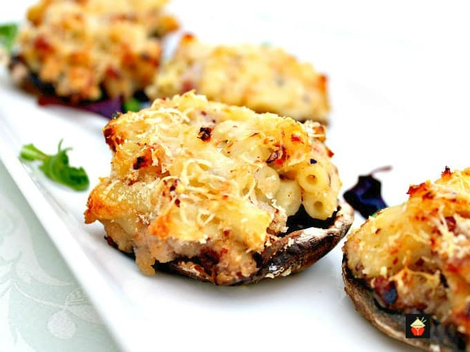 Mac N Cheese Stuffed Mushrooms is so delicious! Easy to make and great for parties or as an appetizer. Baked mushrooms stuffed with a creamy macaroni and cheese filling with bacon too!