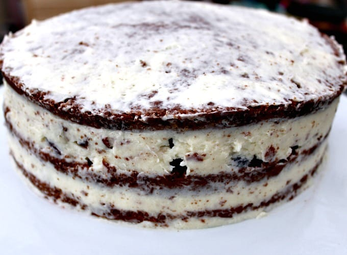 Authentic German Black Forest Cake - Schwarzwalder Kirschtorte, showing cake assembly and crumb coating
