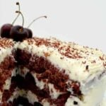 Authentic German Black Forest Cake, Schwarzwalder Kirschtorte is a delicious cake famous in Germany. Layers of chocolate cake, black cherries, and kirsch. Perfect for a party!