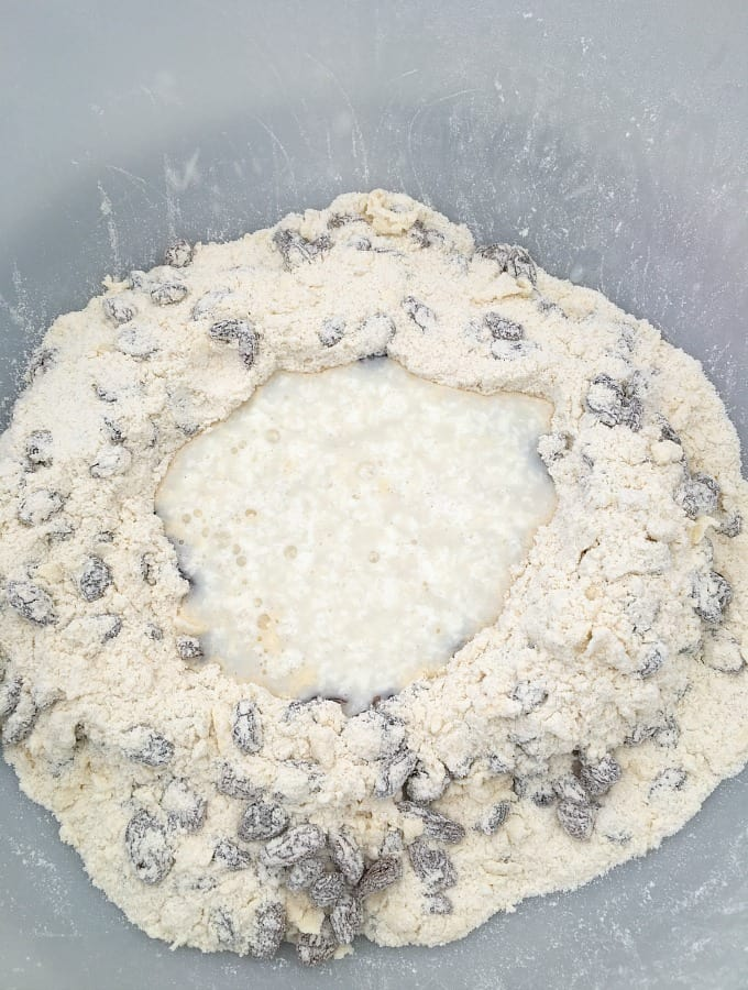 Pour milk mixture in to well