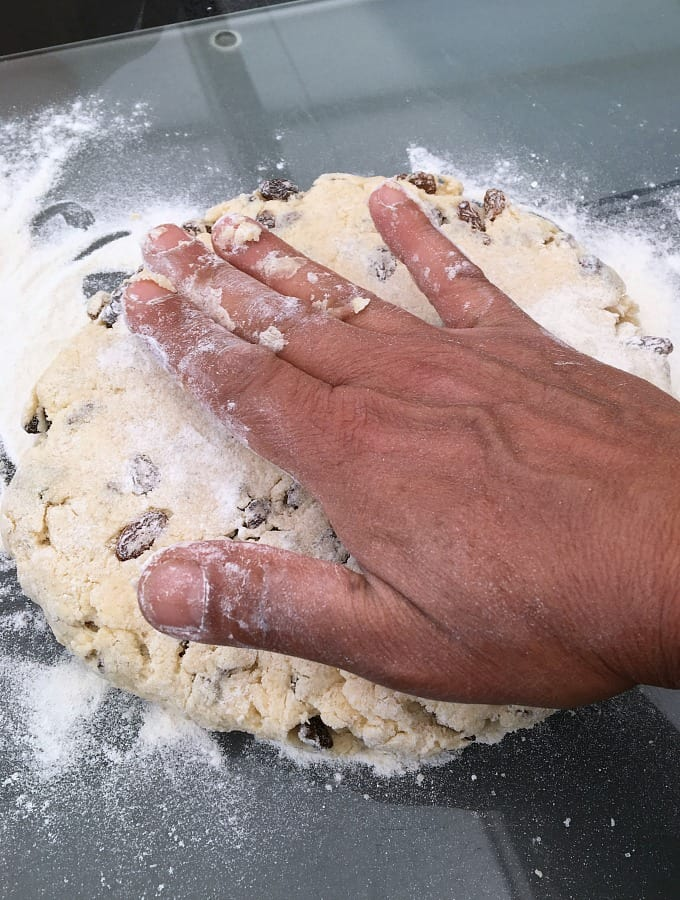 Showing thickness of scone mixture