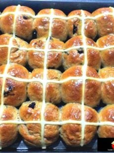 Easy Hot Cross Buns are a wonderfully soft, sweet, spiced bun, traditionally made for Easter time. Serve warm or cold, split open, toast and spread some butter and your favourite jam! Delicious!