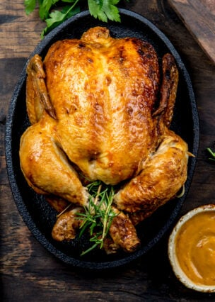 Sunday Roasted Whole Chicken Dinner, a very easy to follow recipe with cook times and instructions for the chicken, gravy, roast potatoes and vegetable side dishes