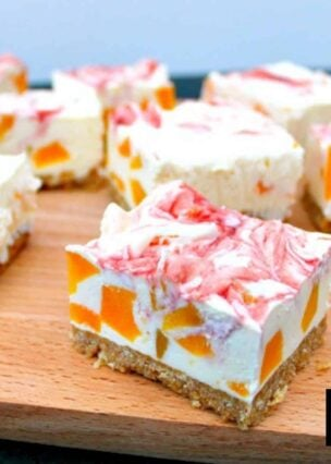 Easy Peach Cheesecake With Raspberry Swirl, a delicious no-bake creamy dessert bursting with juicy peaches. Quick and easy to make and great for parties too!