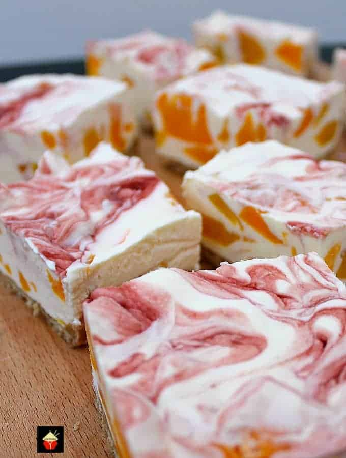 Easy Peach Cheesecake With Raspberry Swirl, a delicious no-bakecreamy dessert bursting with juicy peaches. Quick and easy to make and great for parties too!