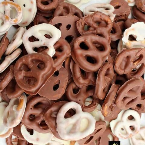Easy Chocolate Party Pretzels are a great snack made up of delicious crunchy salted pretzels and a variety of chocolate. Once you start eating these you can't stop!