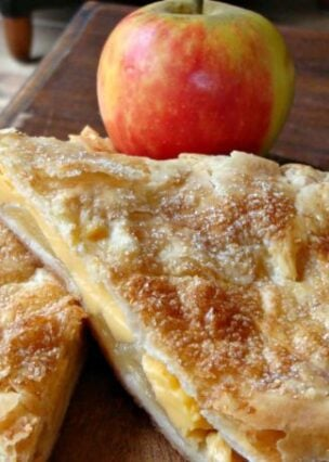 Apple custard strudel .A deliciously crisp, flakey pastry filled with apples and custard. Made from scratch a really easy dessert recipe. Serve warm & add a blob of whipped cream!