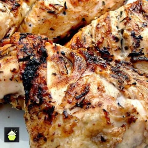 Flattened Moist BBQ Garlic and Lemon Chicken with a delicious marinade to give you juicy chicken every time. Easy instructions of how to cut a whole chicken into portions.