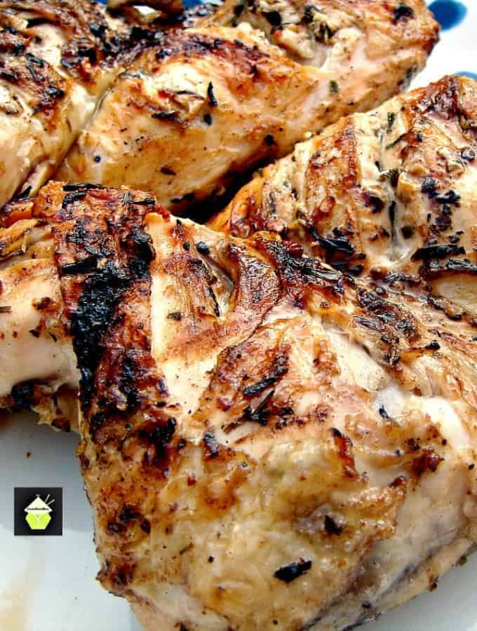 Flattened Moist BBQ Garlic and Lemon Chicken with a delicious marinade to give you juicy chicken everytimeFlattened Moist BBQ Garlic and Lemon Chicken with a delicious marinade to give you juicy chicken every time. Easy instructions of how to cut a whole chicken into portions.