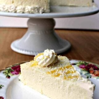 Fluffy Lemon Ricotta Cheesecake is a lovely baked dessert and so light and airy. Perfect for Easter, Mother's Day or any time of the year! It's out of this world delicious!