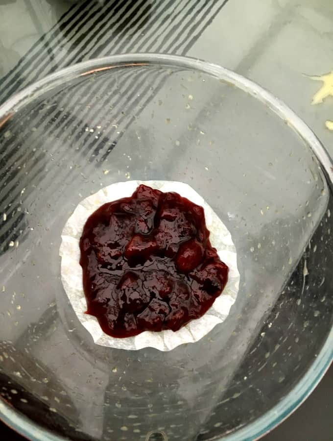 Delicious Steamed Cherry Cake, add cherry jam to base of pudding basin