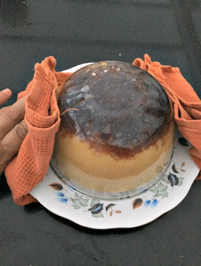 Delicious Steamed Cherry Cake, showing how to transfer cake from pudding basin to a plate