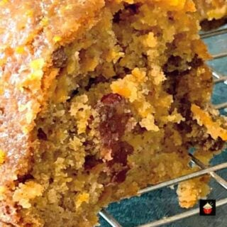 Easy Cranberry and Orange Carrot Cake! A delicious cake made from scratch with a lovely orange glaze. Fluffy, soft and bursting with the flavors! Perfect breakfast, brunch or to have with a coffee!
