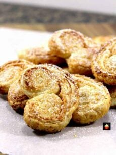 French Almond Palmier cookies or Elephant Ears are a delicious little cookie filled with almonds and perfect for the holidays! Quick and easy to make too!
