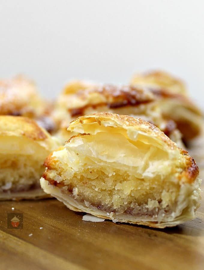 Mini Frangipane tarts are delicious almond cake filled mini tarts in a crispy puff pastry case. Delicious served warm from the oven or cooled with a blob of ice cream or fresh whipped cream!
