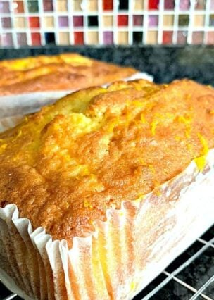 Moist Lemon or Orange Pound Loaf, a wonderful soft and delicious cake using freshly squeezed juice and zest. Bake in a loaf or bundt pan. You choose!