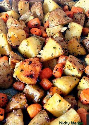 Spiced - Oven Baked Potatoes & Baby Carrots. A popular family recipe and very flexible with the flavors and ingredients. An easy sheet pan side dish