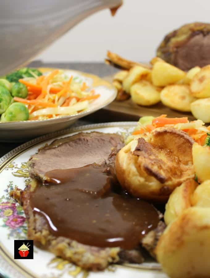 Roast Beef Dinner with cook times for rare, medium and well done. Juicy tender beef served with all the sides!