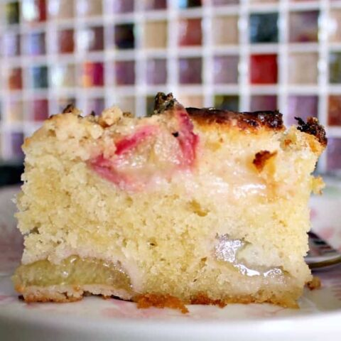 Easy Homemade Rhubarb Cake. The Best ever rhubarb cake. Quick & easy made from scratch recipe with a delicious cinnamon streusel crumble topping. Great tasting sweet & tangy cake. Great for dessert or tea time