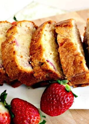Strawberry Pound Cake. A delicious recipe bursting with fresh strawberries. Soft, moist and perfect with a morning coffee or to take to friends!