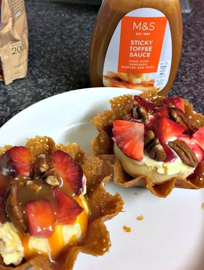 Brandy Snap Baskets, a great dessert filled with ice cream, fresh fruits and a drizzle of caramel sauce.
