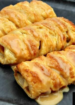 Mini Caramel Apple Pastries. Delightful mini pastries filled with caramel and apples and so easy to make! Delicious crisp, sweet puff pastry. A great snack for afternoon tea too!