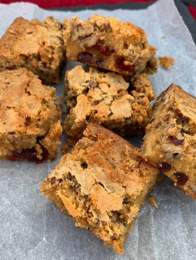 White Chocolate and Pecan Cranberry Brownies (Blondies). Deliciously gooey and decadent white chocolate brownies with pecan nuts and cranberries for a festive twist. Crispy outer layer, dense and fudgy inside, just as a brownie should be.