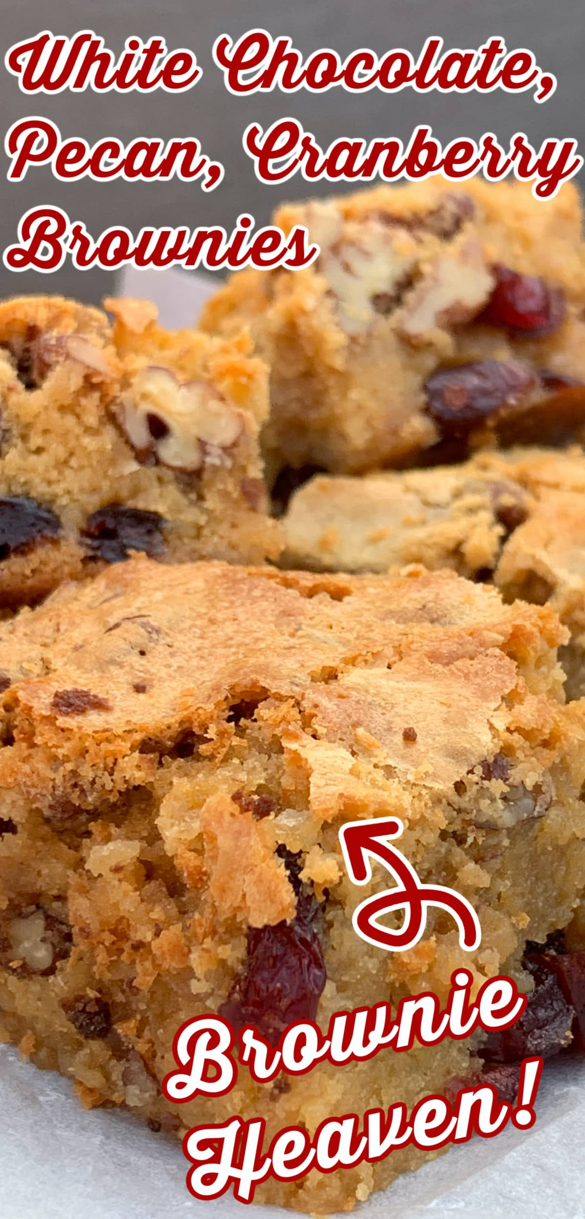 White Chocolate and Pecan Cranberry Brownies (Blondies). Deliciously gooey and decadent white chocolate brownies with pecan nuts and cranberries for a festive twist. Crispy outer layer, dense and fudge inside, just as a brownie should be.