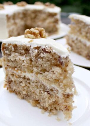 Easy Walnut Cake is a delicious easy recipe. The cake is so soft and fluffy! Recipe also for a lovely vanilla frosting. You can make this as a round cake or a loaf, instructions for both. Freezer friendly too. This would also make a nice cake for the holidays!